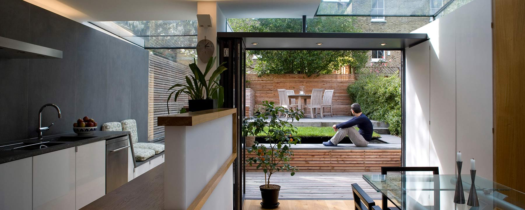 view outside from the kitchen of a London house extension with aluminium bi-fold doors
